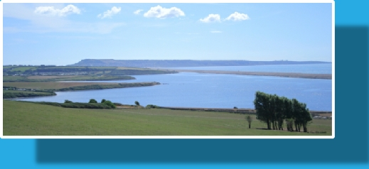 The view across the Fleet Lagoon to the Chesil Beach from Sea Barn Farm